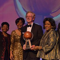 Aflac CEO Dan Amos accepted the Salute 至 Greatness award